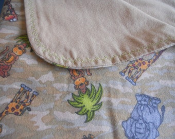 Jungle animals on a camouflage background blanket. Great blanket for any baby or toddler boy. Flannel blanket.