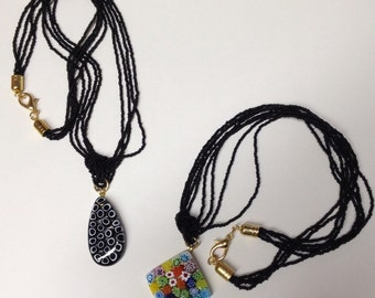 MURRINE: Bugles and Medallion necklaces with Venetian blinds.