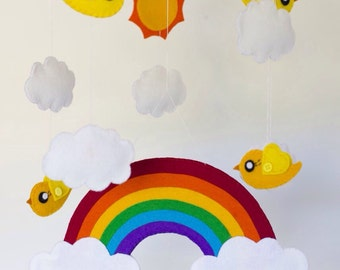 Bright rainbow baby mobile with clouds, yellow birds and sun