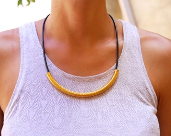 Black and gold curve tube necklace