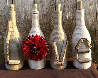 "Wine bottle decor with the word ""love"".  Bottle size may vary."