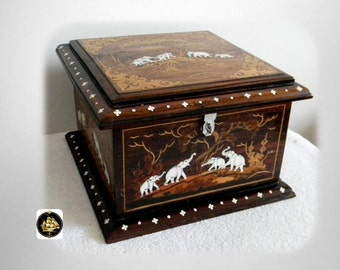 Inlaid vintage wooden box with designs and elephant scenes