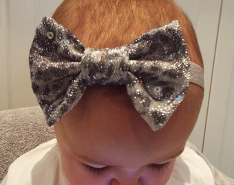 Sparkly silver  3 inch bow on a silver soft elastic headband baby, toddler or girls new