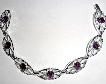 Pretty lightweight vintage Sarah Coventry silvertone link bracelet with purple rhinestones