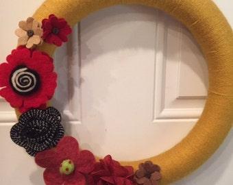 Yellow Yarn Wreath with Flowers