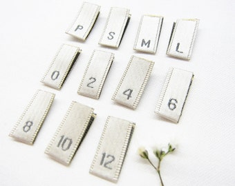 Woven Size Tabs - Ivory Clothing Labels with Gray Letters - Center Fold - 8 MM (W) x 18 MM (H) Folded Size - 50 or 100 PCS