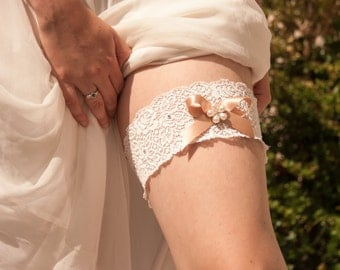Vintage style lace wedding garter with pearls and crystals. A gently elasticated ivory wedding garter  with swarovski crystals