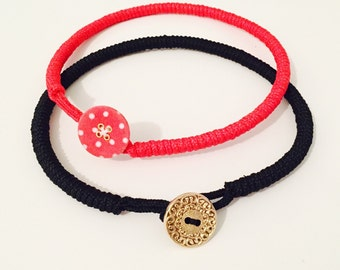 Necklace with colored strap button