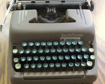 A Cool Vintage 50's era,Brown Mid Cenutry SMITH-CORONA Typewriter With Green Keys.