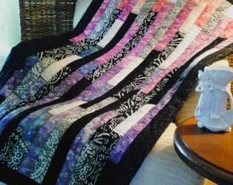 Boho style modern black/purple/pink batik lap quilt