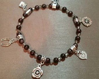 Beaded anklet with silver charms