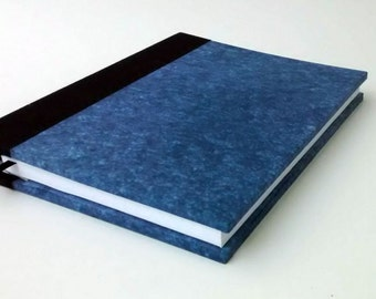 Book Grand Eco blue recycled paper with a visual effect that makes you want to touch her soft and fine ideal finish for you
