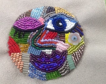 Who's Winking at You? - Beaded embroidery face handmade with a rainbow of seed beads