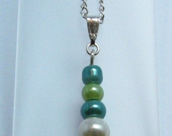 Green faux pearl and butterfly pendant
