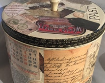 Vintage canister.  Upcycled with vintage and antique ephemera. Lid has Bakelite knob.  Collaged storage or art.