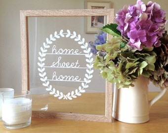 Home Sweet Home Paper Cut. Hand cut home sweet home design set in a beautiful illusion frame.