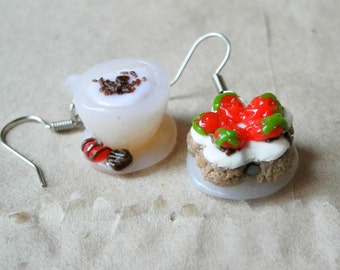Delicious earrings sweets with fragrant coffee and cake.