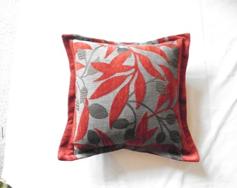 Australian Made Cushion in popular floral fabric in reds and greys.