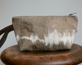 Dyed recycled canvas clutch.