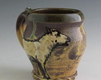 Mug with sheep slip trailed pottery