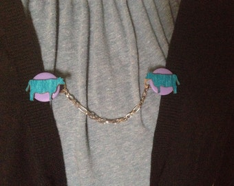 blue cow sweater clip
