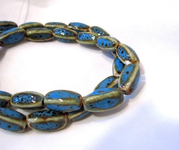 32 Aqua and Honey Glazed Porcelain 4 sided oval beads. Size approx 12x7mm-13x8mm POR 010