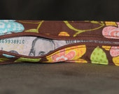 Travel belt brown with flowers
