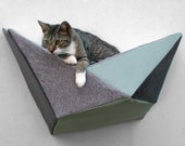 Cat shelf wall bed in pale aqua and grey geometric