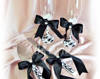 Damask wedding cake cutting set and champagne glasses.  Damask black and white wedding decorations.