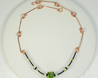Sputnick, handmade, copper and black wire beaded necklace witha green/yellow lampworked focal bead