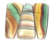 Three Luminous Banded Fluorite Cabochons