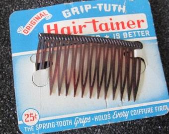 Vintage hair comb, still on card