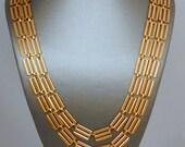 Striking and versatile brassy brass 2-strand necklace