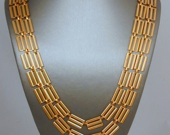 Striking and versatile brassy brass 2-strand necklace