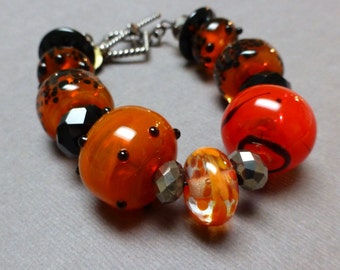 Lampwork Glass Bracelet. Bali Silver. Orange. Black. Boho. Gothic. Large Bead Bracelet. Handmade Jewelry.