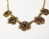 Christmas statement necklace: Festive, Christmas coloured bright red, green and blue gold tone filigree statement pendant necklace