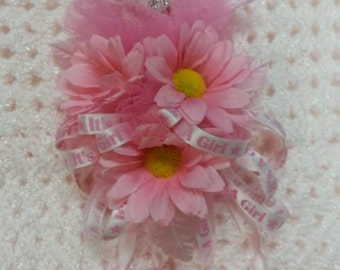 """B6) Pink Daisy Baby Sock Corsage with """"It's A Girl"""" Ribbon & Diaper Pin for a Baby Shower"""