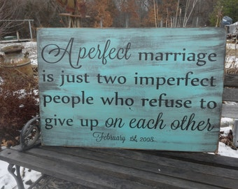 A perfect marriage is just two imperfect people who refuse to give up on each other sign