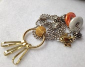 Golden Airplane ID Badge Lanyard with orange charm accents and key hooks