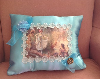 Throw pillow with image of Victorian ladies at the water with mermaid