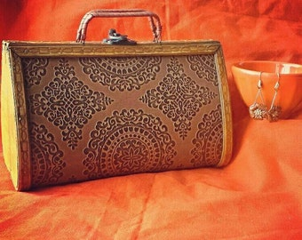 Indian summer wooden purse with embossed hand tooled leather scroll design from the 1970s.