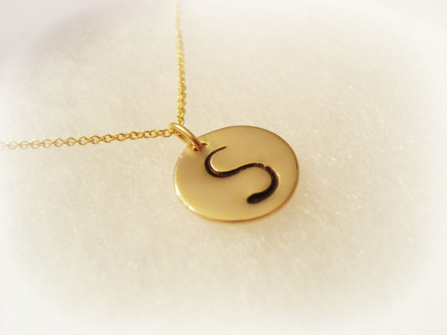 Large Initial in Gold