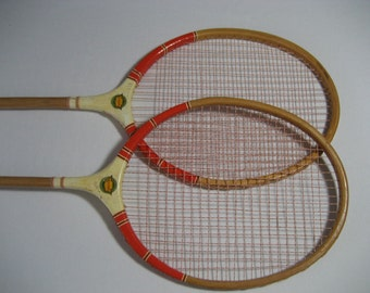 pair of vintage badminton racquets with bright paint