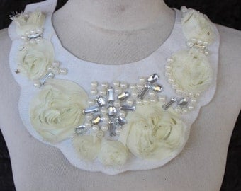 White color  embroidered and beaded applique with cream color chiffon flowers