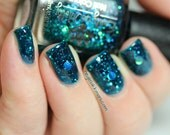 "Nail polish - ""Oceanic Forces"" holographic dot glitter in a dark teal base"