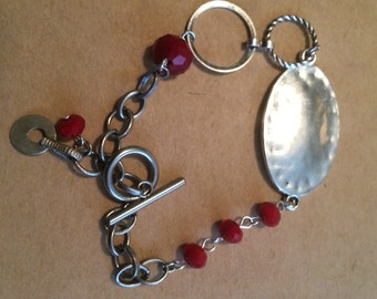 Ruby bead and silver bracelet