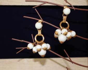 White and gold dangle clip earrings
