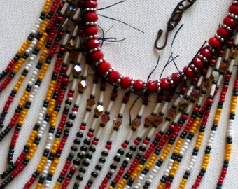 Native American beaded necklace in red, marigold, white and green