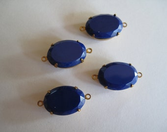 4 Blue Connectors in Brass Setting
