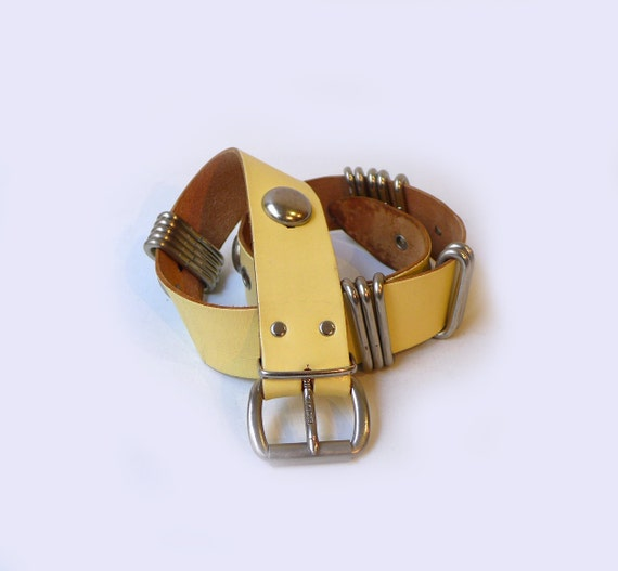 vintage retro pale yellow leather belt with chunky silver
